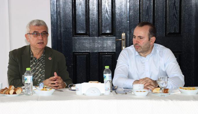 Mustafa Tutuk, 14 mahalle muhtarıyla bir araya geldi